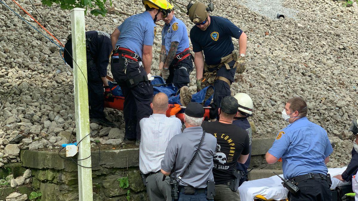 Worker rescued after falling down hill near Arlington Avenue