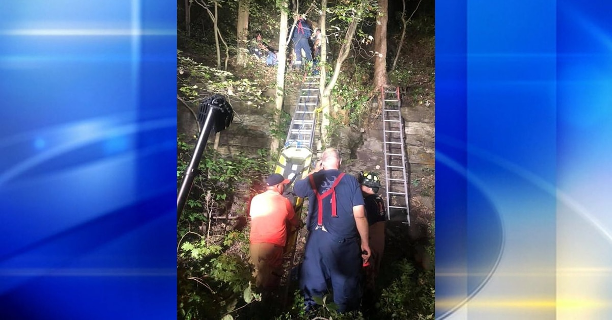 Difficult rescue saves man who fell down 60-foot embankment near train tracks