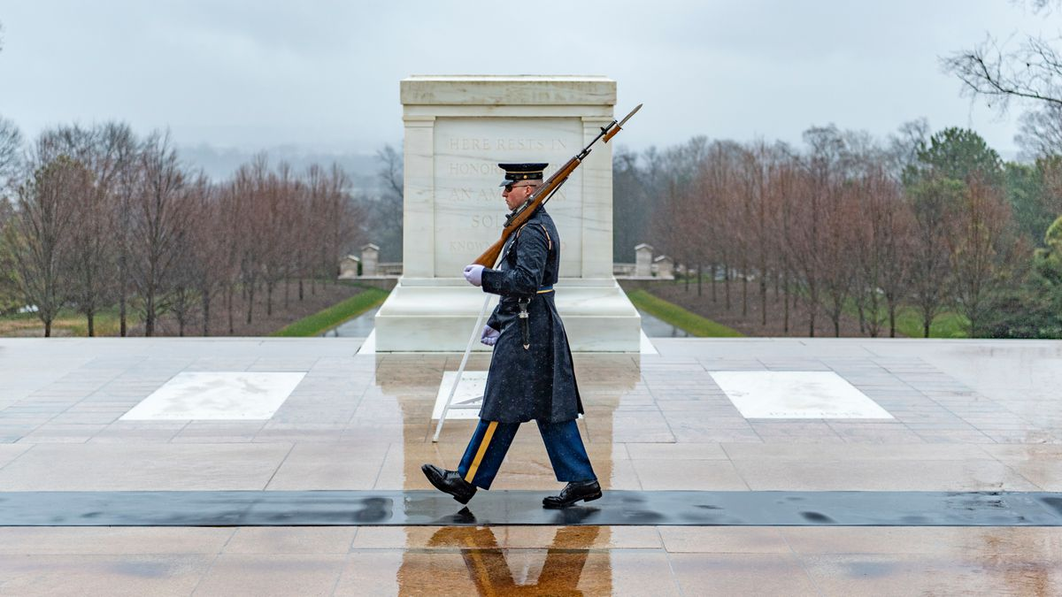FILE PHOTO: A sentinel walks the mat in front of the Tomb of the Unknown Soldier during a rainy day at Arlington National Cemetery, Arlington, Virginia, Feb. 25, 2020. The sentinels are still fulfilling their mission despite the COVID-19 outbreak.