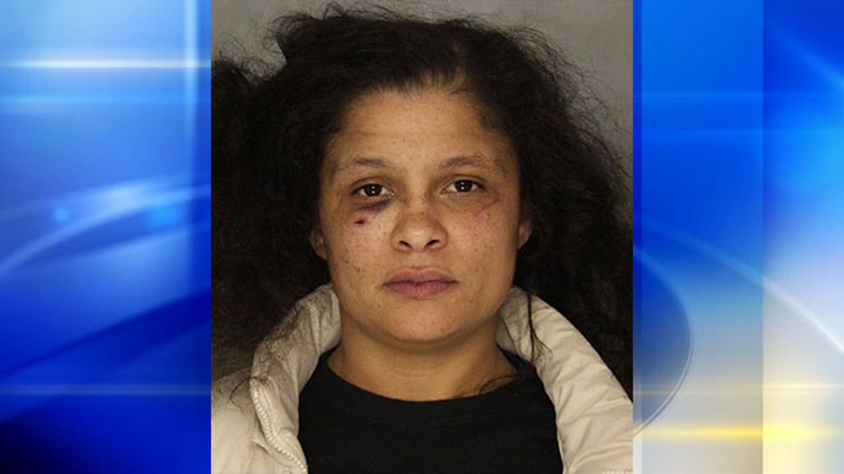 Parking spot leads to fight, woman being pinned between 2 vehicles